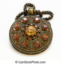 Vintage amulet on a white background