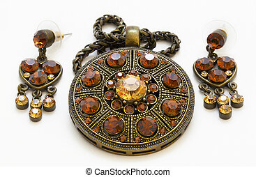 Vintage amulet and earrings - Vintage amulet on a white...