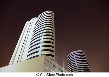 Highrise buildings at night. Dubai, United Arab Emirates
