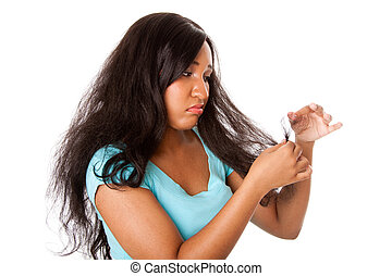 Split hair tips - Teenage girl sad about her frizzy hair...