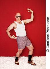 Musular Buffoon - Bald Caucasian man wearing boxer shorts...