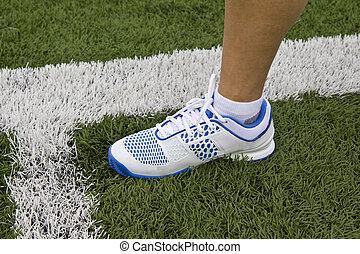In Playing Field - Women's athletic shoe inside of white...