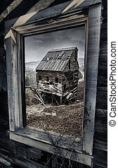 Old abandoned mine in Colorado seen from the window - View...