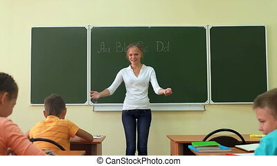 Dear teacher - Three pupils coming up to their teacher and...