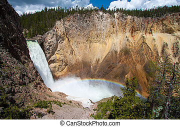 Rainbow over the waterfall in Yellowstone National Park, WY...