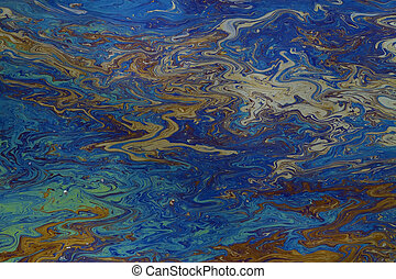 oil slick on water - background of an oil slick on water...