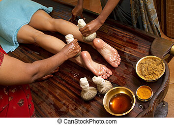 traditional indian ayurvedic oil foot massage - indian...