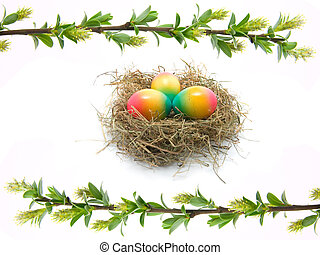 close up photo of a branch pussy willow with colored Easter eggs in the nest