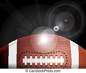 American football ball on black background with light
