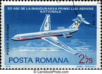 airpplane IL-62 - ROMANIA - CIRCA 1976: A stamp printed in...