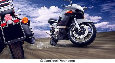 Two motorcycles on the speed on outdoor road