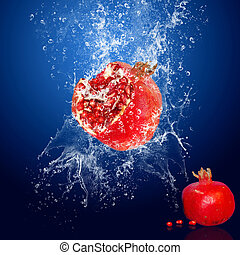 Water drops around red fruit on blue background