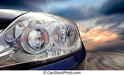 Beautiful blue sport car on road - Headlight of car