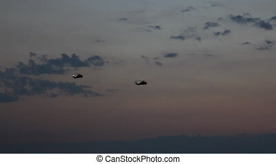 2 blackhawks - blackhawks fly at sunset, shoot Canon 5D Mark...