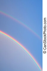 colorful rainbow - detail of a rainbow on the blue sky in...