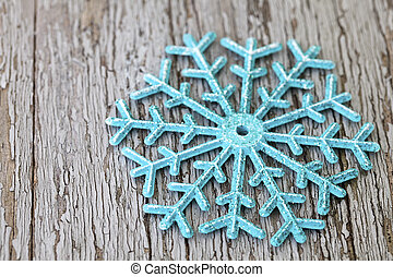 turquois christmas star on wood