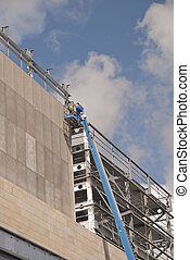 Blue Cherry Picker - A Blue Cherry Picker Platform on a...