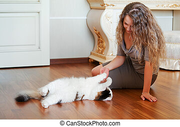 Beautiful woman with a cat - Beautiful woman playing with a...