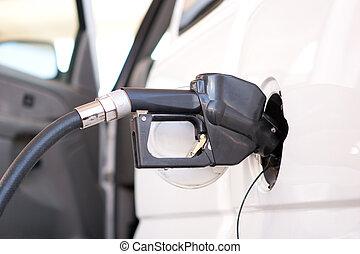 Fuel pump nozzle - A fuel pump nozzle inserted into a...