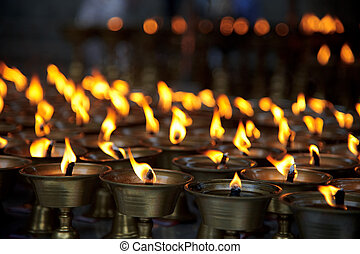 Burning candles in a Buddhist temple