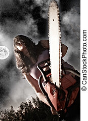 woman with chainsaw - vampire with chainsaw on sky...