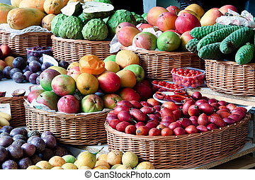 Close-up of a fruit and vegetable stall in Funchal covered...