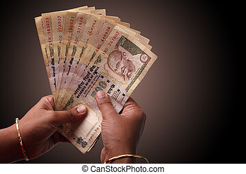 Woman counting indian money - Woman counting a few 500...
