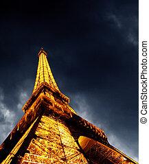 PARIS - JUNE 22 : Illuminated Eiffel tower at night sky June...