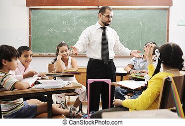 Education activities in classroom at school, happy children...
