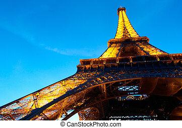 PARIS - JUNE 23 : Illuminated Eiffel tower at night sky June...
