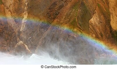 Rainbow at Lower Falls -Yellowstone - Sunlight creates a...