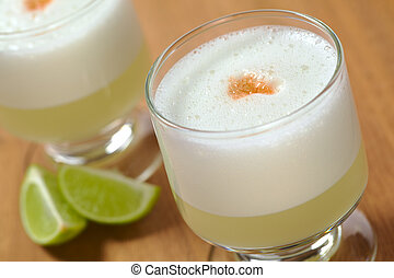 Peruvian cocktail called Pisco Sour made of Pisco (Peruvian...