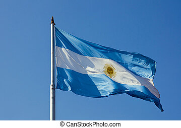 Argentinean flag - An Argentinean flag in front of a blue...