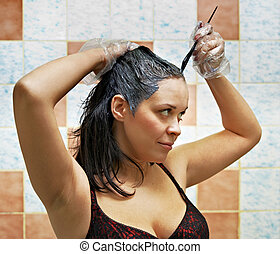 woman dyeing hairs - pretty beautiful young woman dyeing...