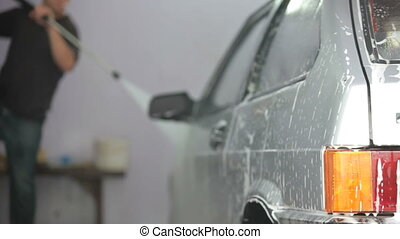 car wash with water pressure - men wash car with water...