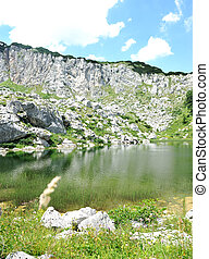 Lake on the top of mountain hills