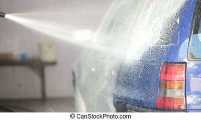 carwash foam - worker puts on a car wash foam