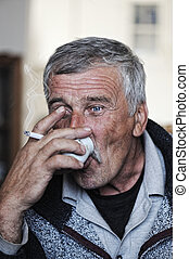 Old man with mustache smoking cigarette and drinking coffee