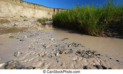Sage Creek - Badlands National Park - Muddy waters flow...