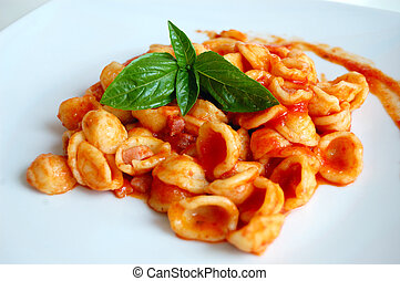 Orecchiette Pasta with Tomato sauce and basil , typical...