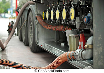 Fuel truck which refill Hoses and pumps to load the truck