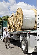 Flatbed 18 Wheeler - Truck bringing a load of Fiber-optic...