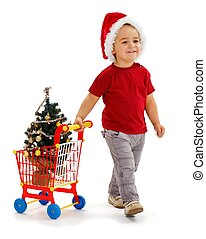 Little boy pulling shopping cart with Xmas tree - Cheerful...