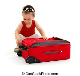 Little boy preparing for trip, zipping suitcase