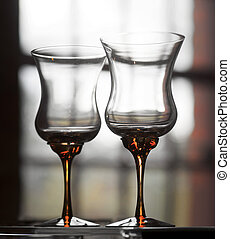Crystal wine glasses - Two crystal wine glasses in front of...