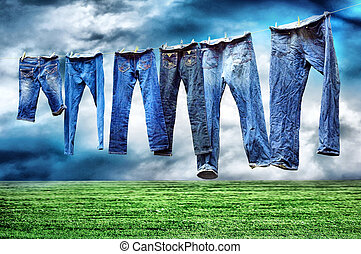 Jeans on a clothesline to dry