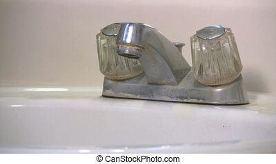 Leaky Sink Faucet - Dirty old leaky bathroom sink faucet...