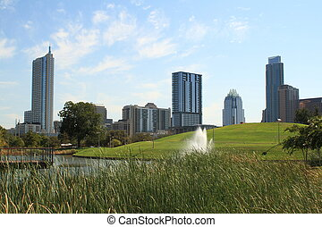 City skyline - Austin Texas city skyline with park fountain...