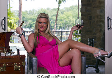Blonde Smoking Cigar - A blonde model smoking a cigar and...