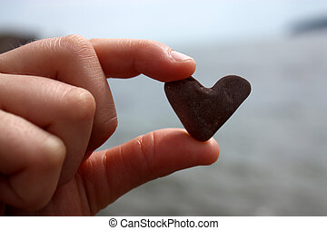 A heart shaped stone - hold in the hand
